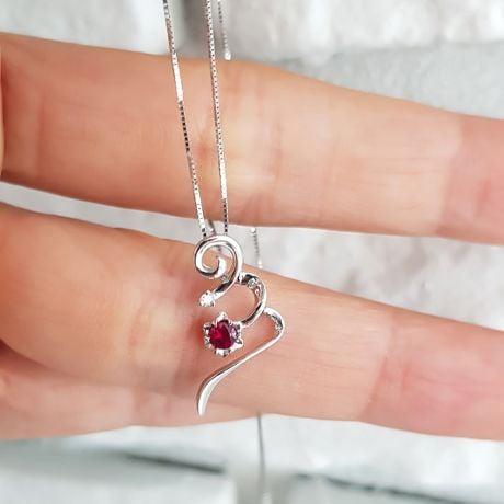 Pendentif tortillon en rubis et diamant - Or blanc