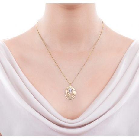 Pendentif et Boucles Kaneo. Perles Akoya, Or jaune, diamants. Motifs cerclés