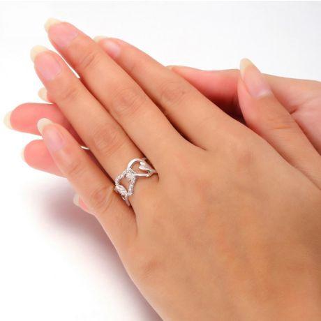 Bague or blanc diamants en forme de succession de coeurs