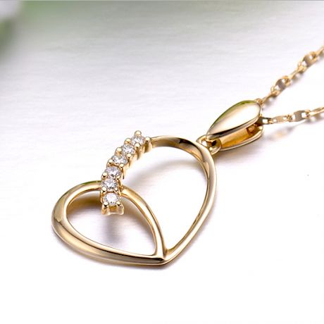 Ciondolo a forma di cuore - Oro giallo e diamanti