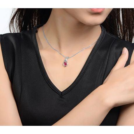 Pendentif rubis 1 carat forme poire. Or blanc 18cts, diamants