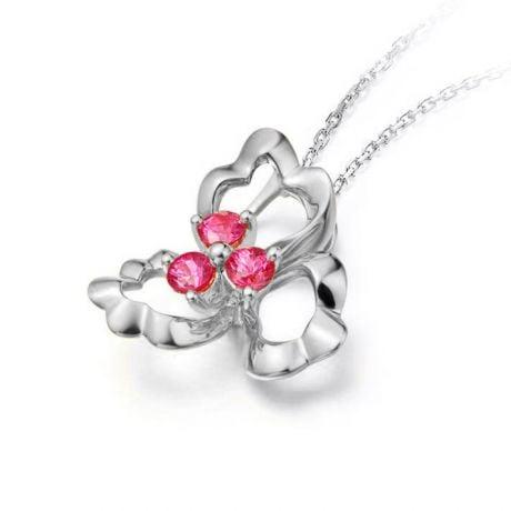 Pendentif fleur à 3 Pétales. Or blanc 18 carats. Rubis
