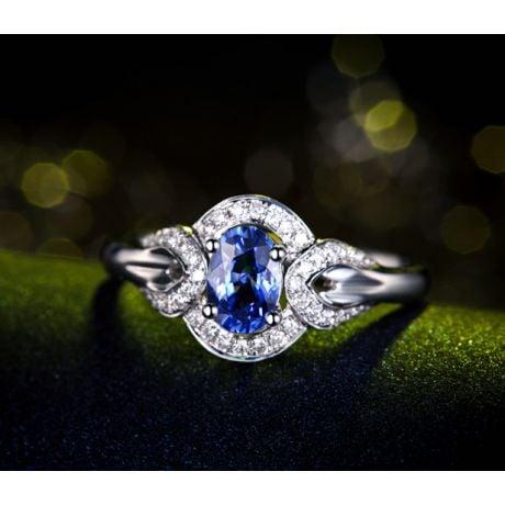 Bague fiançailles saphir diamants et or blanc. Motifs bouclés