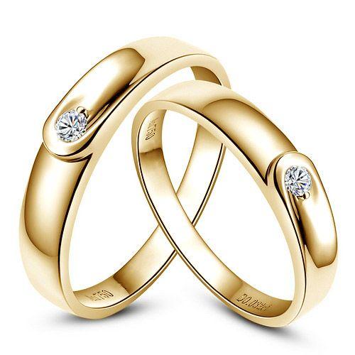 Alliances diamants et or jaune - Duo d'anneaux