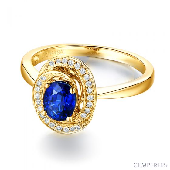 Bague saphir bleu. Or jaune, diamants myriade
