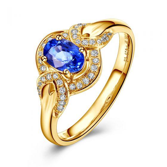 Bague fiançailles saphir diamants et or jaune. Motifs bouclés