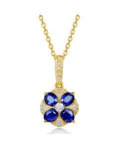 Pendentif solitaire fleur bleue. Or jaune, saphirs et diamants