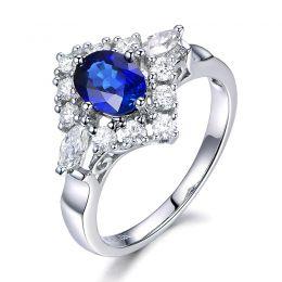 Bague fiançailles saphir diamants et or blanc.