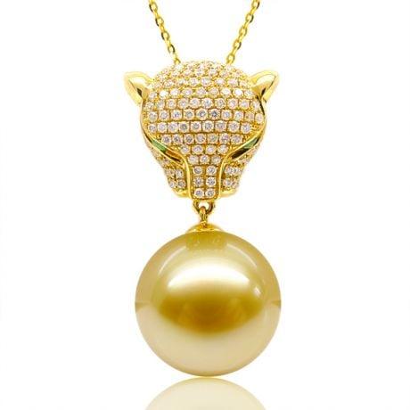 Pendentif Panthère Perle d'Australie dorée. Or jaune et Diamants