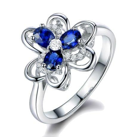 Bague fleur Or blanc fleur anémone. Diamants, saphirs