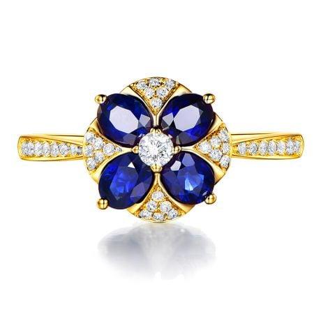 Bague solitaire fleur bleue. Or jaune, saphirs et diamants